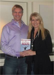 Dwayne and Laura holding the Remarkable Man Project Book